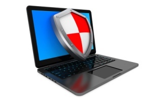 Antivirus concept. Laptop computer protected by shield