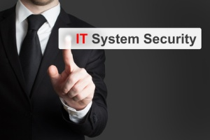businessman in black suit pushing button it system security